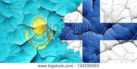 Kazakhstan flag with Finland flag on a grunge cracked wall