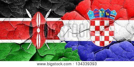 Kenya flag with Croatia flag on a grunge cracked wall