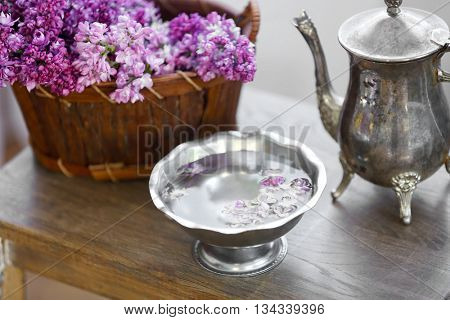 Bouquets of purple lilac spring flowers on wooden background