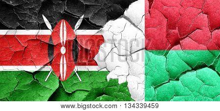 Kenya flag with Madagascar flag on a grunge cracked wall