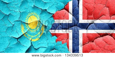 Kazakhstan flag with Norway flag on a grunge cracked wall