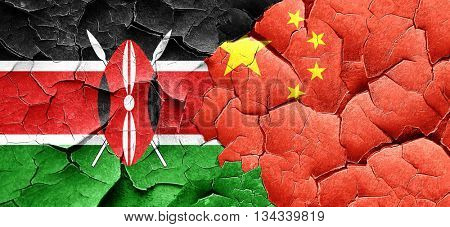 Kenya flag with China flag on a grunge cracked wall