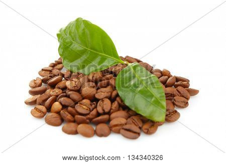 Coffee beans and green leaves, isolated on white