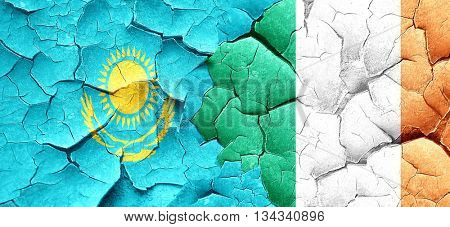Kazakhstan flag with Ireland flag on a grunge cracked wall