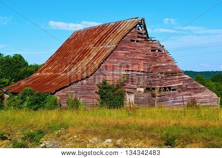 Rustic collapsing abandoned barn taken in the rural Tennessee countryside