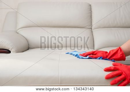 cleaning leather sofa at home horizontal composition