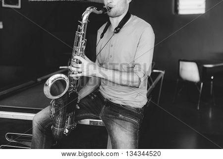 Jazz man Musical Artist Playing Saxophone Concept