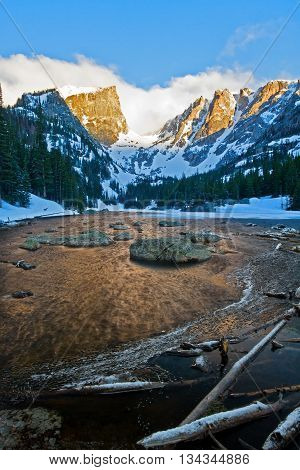 Hallett and Flattop peaks basking in the warm sunlight of the morning sunrise in Rocky Mountain National Park