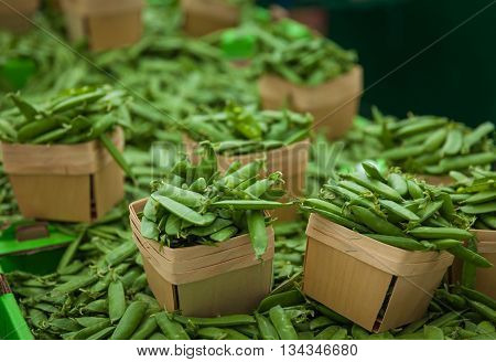 green peas in the baskets on markets