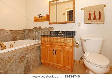 Cowboy Bathroom With Rocks Around Tub