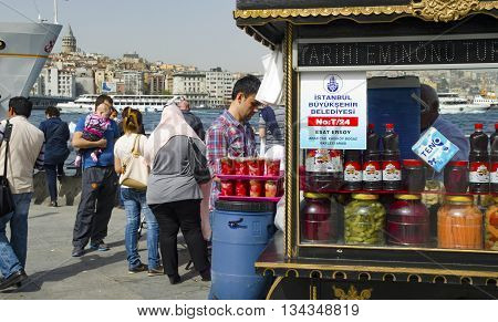 Istanbul Turkey - April 6 2013: Istanbul Eminonu pickle vendor. Traditional Turkish pickles of various fruits and vegetables. There is an important place in Turkey and produced first by the Turks.