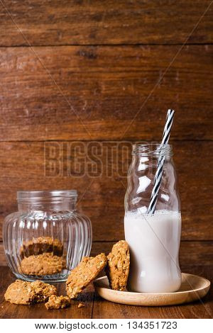 Stack Of Whole Grains Cookies With Milk Bottle