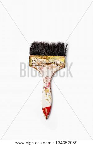 old dirty paint brush on a white background