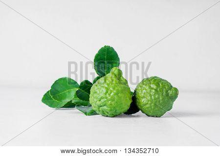 Bergamot Fruit On White Wooden  Background .