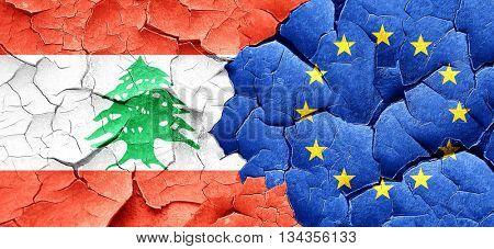 Lebanon flag with european union flag on a grunge cracked wall