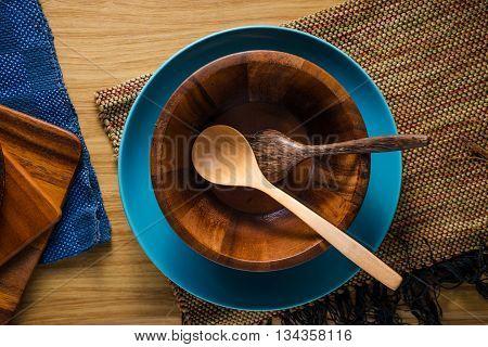 pile of wooden kitchen utensils on wooden background.