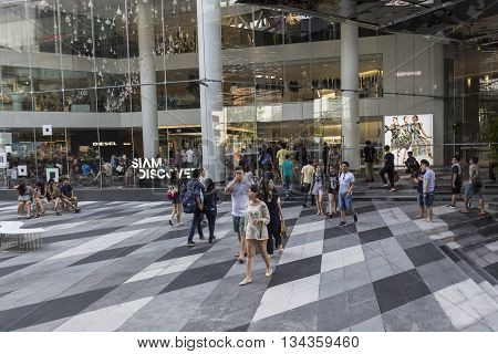 BANGKOK THAILAND - MAY 29 : people and tourist in open space at Siam discovery after renovate in siam square on may 29 2016 thailand. siam discovery is popular shopping mall in siam square