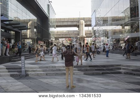 BANGKOK THAILAND - MAY 29 : activity of people in open space between Siam discovery and Siam Center after renovate in siam square on may 29 2016 thailand. siam square is one of landmark for tourist in bangkok