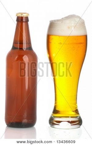 Bottle and glass of beer on a white background