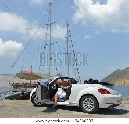 GREECE. ISLAND RODOS- June 16, 2013. The car is a Volkswagen convertible on the waterfront of the city of Rhodes test drive. Greece, Rhodes