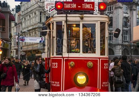 Istanbul Turkey - December 29 2013: A historic tram in front of the Beyoglu station of Tunel (1875) at the southern end of Istiklal Avenue.