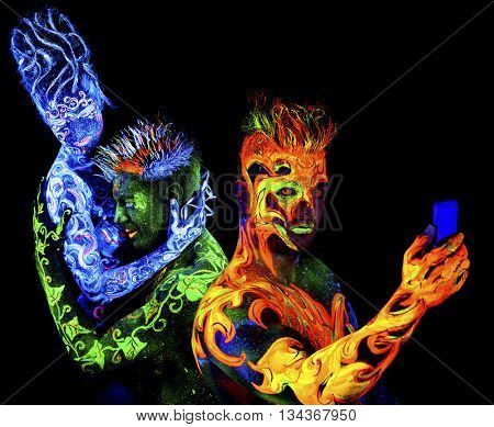 Fire, Body art glowing in ultraviolet light, isolated on black background. Land Loves Air