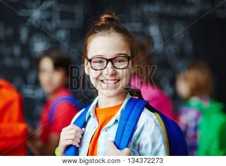 Portrait of smiling schoolgirl wearing eyeglasses
