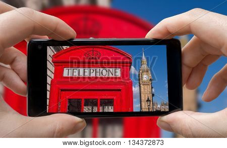 Tourist Is Taking Photo Of Red Phonebooth In London With Smartph