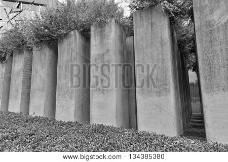 July 2015 - The Jewish Museum Berlin Berlin Germany: The Garden of Exile and Emigration.The 49th column filled with earth from Jerusalem stands for Berlin. The whole garden is on a 12° gradient and disorients visitors.