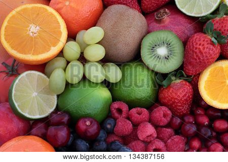 Healthy fresh fruit super food background with fruits. High in antioxidants, vitamins, anthocyanins and dietary fiber.