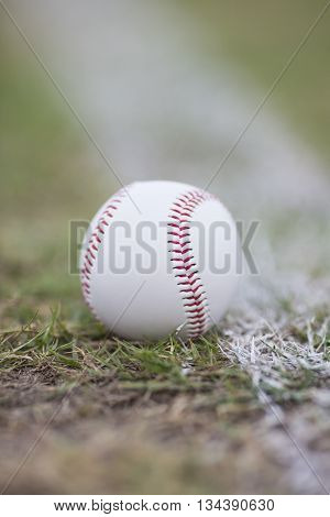 close up baseball on the infield chalk line
