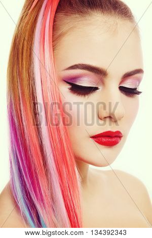 Vintage style portrait of young beautiful girl with colorful ponytail and cat eye make-up