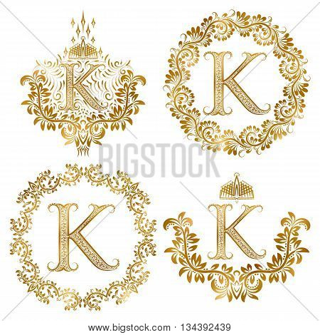 Golden letter K vintage monograms set. Heraldic monogram in coats of arms form letter K in floral round frame letter K in wreath heraldic monogram in floral decoration with crown.