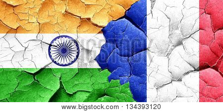 India flag with France flag on a grunge cracked wall