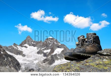 Hiking shoes on the rock, in the background mount Gabelhorn - Pennine Alps, Switzerland