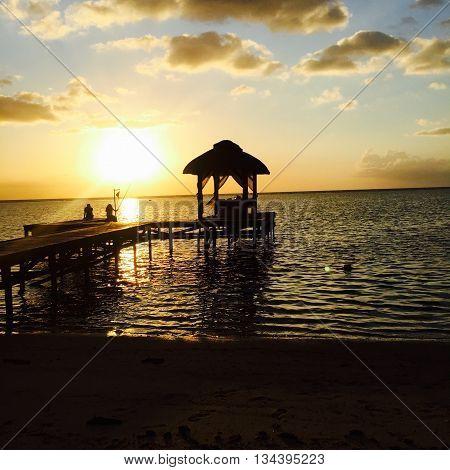 PONTOON ON THE BEACH  AT SUNSET , MAURITIUS ISLAND