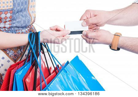 Close-up Of Man And Woman Hands Fighting For Credit Card