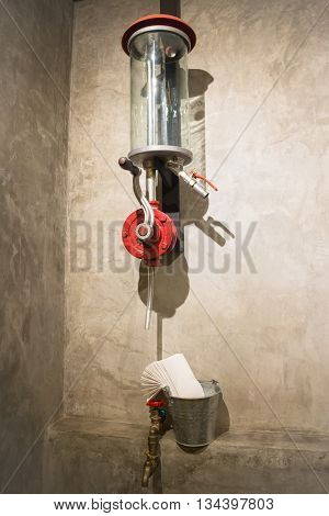 Vintage water tap decotated on grey wall stock photo