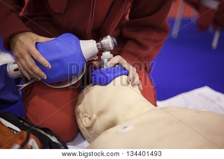 Paramedic demonstrate Cardiopulmonary resuscitation (CPR) on dummy. Artificial respiration.