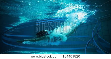 Athletic swimmer smiling at camera underwater against feet of woman standing on the edge of the pool
