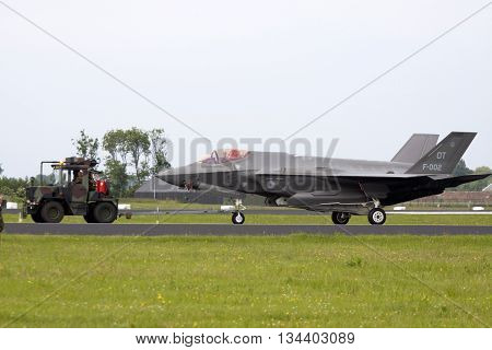 Leeuwarden , the netherlands - 11 juni 2016: F 35 joint Straight fighter is towed to the hangar after a demonstration flight. this replaces the F16 at the Dutch Air Force