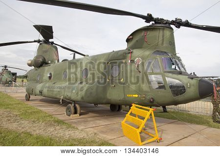 Leeuwarden , the netherlands - 11 juni 2016: Parked green Chinook CH-47, Tandem rotor military helicopter.