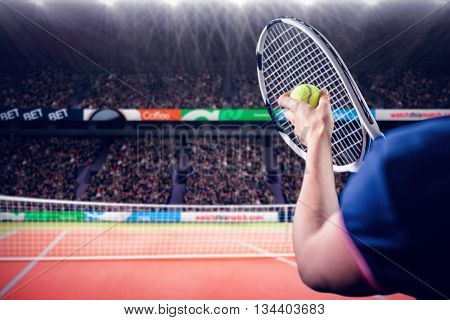 Tennis player holding a racquet ready to serve against facing view of net on tennis field