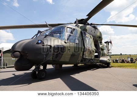 BERLIN / GERMANY - JUNE 3 2016: tactical troop helicopter NH90 from nato helicopter industries stands in berlin germany on june 3 2016.