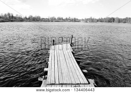 Pier on the Lake Vuoksa the Karelian Isthmus. Black and white.