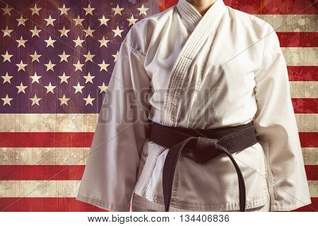 Mid section of karate player against usa flag in grunge effect