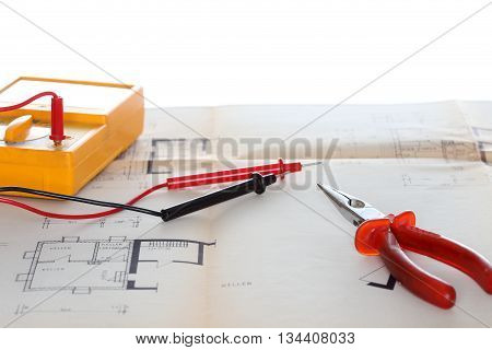 electrical instrument with tools on a blue print