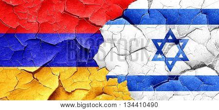Armenia flag with Israel flag on a grunge cracked wall