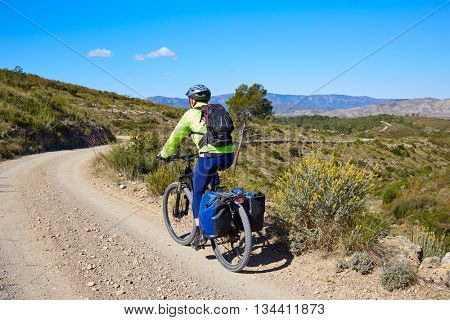 Biker MTB cycle tourism with panniers in Turia Park at pedralba of valencia poster