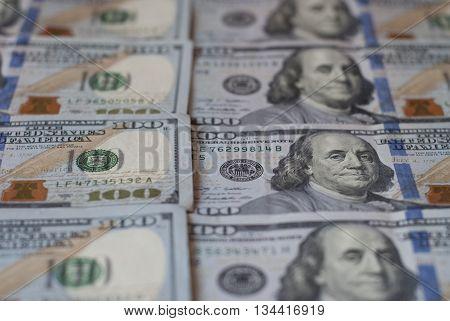 New hundred dollar bills, rows of aligned banknotes closeup